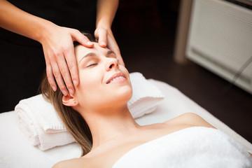 Woman enjoying a facial massage