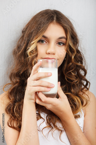 Young cute girl with glass of milk