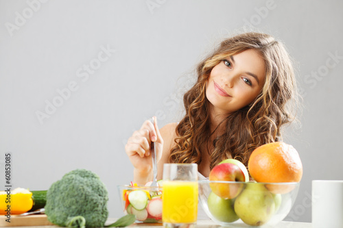Young cute girl having breakfast