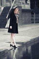 Woman with umbrella walking in the rain