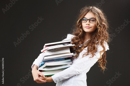 Young cute girl with stack of books