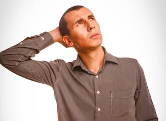 Man looking up scratching his head studio