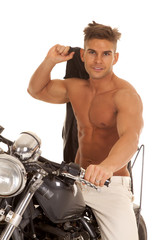 man no shirt jacket over shoulder on motorcycle