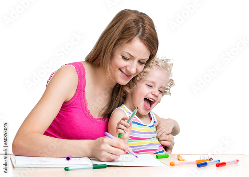 Mother and kid draw together