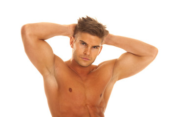 strong man with hands behind head upper body