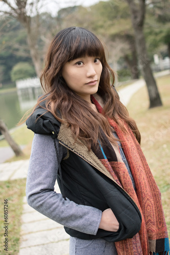Elegant Asian woman, closeup portrait in outdoor.