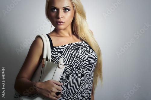 Fashionable Beautiful Blond Woman with White Handbag.Shopping