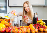 woman making fruits beverages with wine