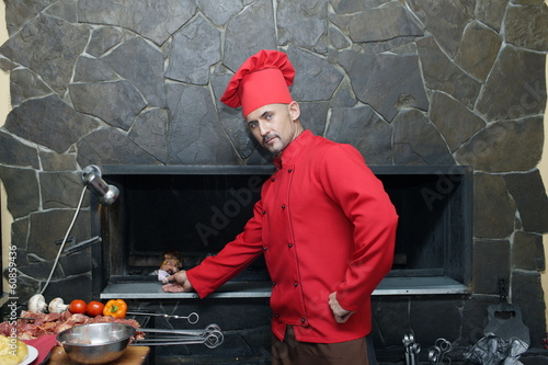 Young cook in a red jacket