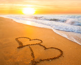 Fototapety two hearts on beach sand
