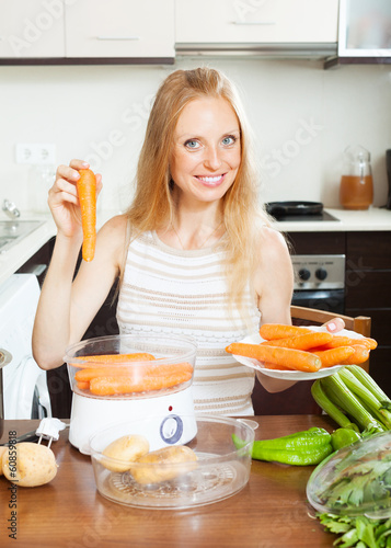 Blonde long-haired housewife cooking vegetables