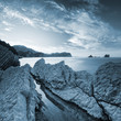 Blue toned landscape with stones and sky on Adriatic Sea coast