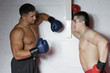 Two boxers in training in the gym