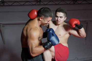 Two boxers are boxing each other in the ring