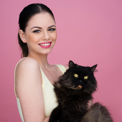Beautiful woman with her black cat