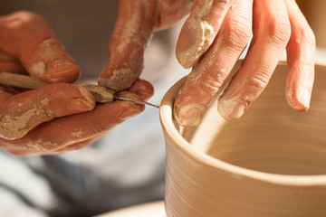 Hands working on pottery wheel ,retro style