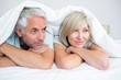Closeup of a mature couple lying in bed