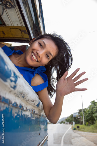 girl waving from the bus