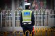 Leinwanddruck Bild - Traffic police officer on the street in Beijing, China