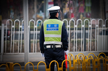 Traffic police officer on the street in Beijing, China