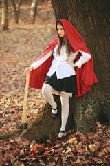 Dangerous Little red riding hood with an axe