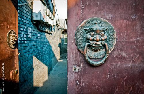 Foto op Aluminium Beijing brass lion head door knockers in hutong area in Beijing, China