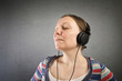Pretty young woman with headphones listening to music.