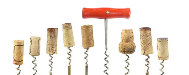 collection of wine corks and corkscrew, isolated on white backgr