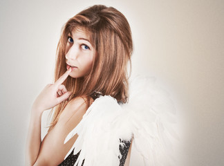 Portrait of cute girl as angel