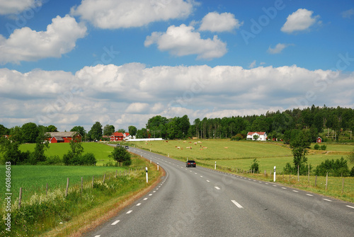 Country landscape with a road and farms