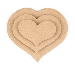 Handmade applique made of cardboard heart. Isolated on white