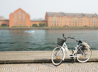 Bicycle loading on wharf of canal in Copenhagen