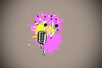 Composite image of microphone on paint splashes