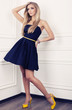 canvas print picture - beautiful girl with blond hair in blue dress