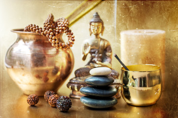 Statue of Buddha, zen stones, incense. Сoncept of meditation