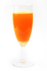 bright orange drink in liquor-glass as element of the setting