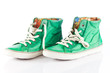 green sneakers isolated on white background