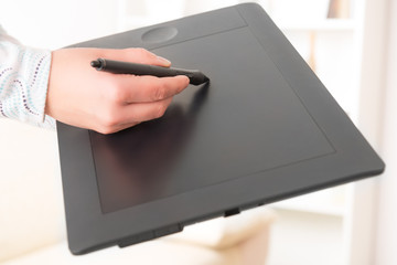 Hands holding graphic tablet