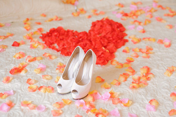 Shoes on Bed with Petals