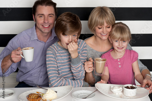 Family of four having great time in restaurant