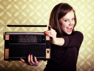 art portrait of young smiling ecstatic woman holding radio playe