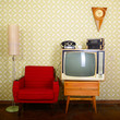 Leinwanddruck Bild - Vintage room with wallpaper, old fashioned armchair, tv, phone,
