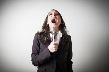 singing beautiful young businesswoman