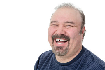Close-up portrait of a funny mature man laughing