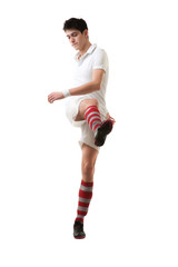 Young football player score goals with raised foot on white back