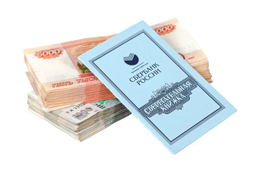Russian rubles bills and savings book isolated on white backgrou