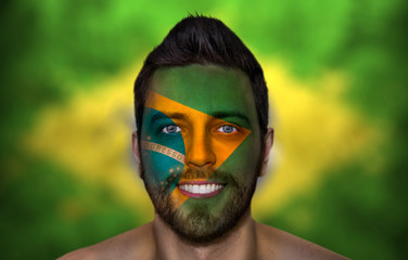 Portrait of a man with a painted flag of Brazil