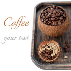 Roasted coffee and green raw coffee in bowls of coconut