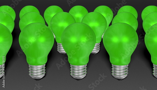 Group of green reflective light bulbs on grey background