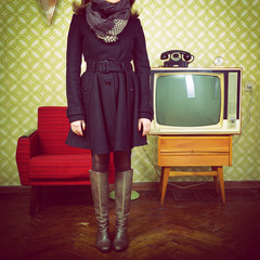 art portrait of young woman standing in room with vintage wallpa